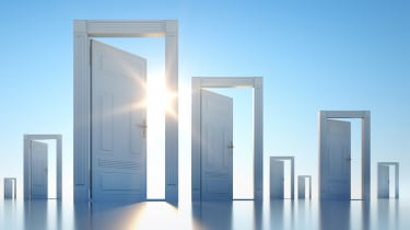 A series of doors open to blue skies.