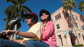 Senior couple on motor scooter in Florida