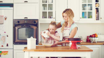 Mother in a kitchen with a small child
