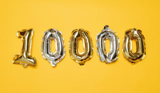Gold and silvr 10,000 number balloons on yellow background. Followers and Subscription Concept