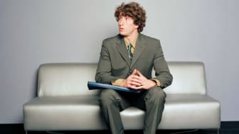 A job interview candidate waits nervously.