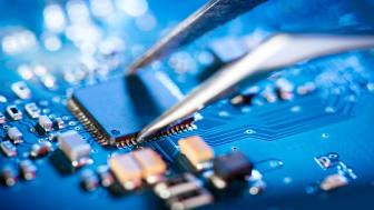 engineer inspecting microchip