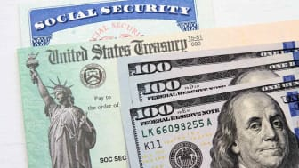 Concept art showing a Social Security card with some money