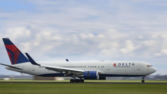 Schiphol, The Netherlands - April 8, 2016: Delta Airlines Boeing 767 airplane landing at Schiphol airport near Amsterdam in The Netherlands during a overcast spring day.