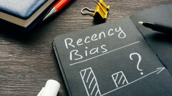 """The word """"recency bias"""" written on a chalkboard."""