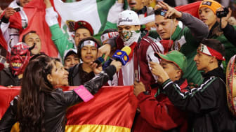 SAN FRANCISCO - FEBRUARY 24:A reporter for Televisa talks with Fans of Mexico and Bolivia before a friendly match in preparation for the 2010 FIFA World Cup on February 24, 2010 at Candlestic