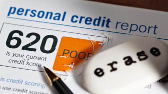 A personal credit report and an eraser