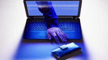 Hand of hacker reaching for wallet from screen of laptop