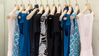 Close-up of women's clothing on a rack
