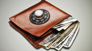 a wallet containing dollar notes with a combination lock on the front