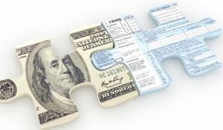 Two puzzle pieces -- one a $100 bill and one a tax return -- fit together.