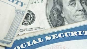 picture of a one-hundred dollar bill and two Social Security cards