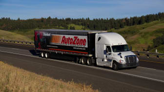 """""""Autozone"""" Semi-Truck Driving along a Rural US Highway."""