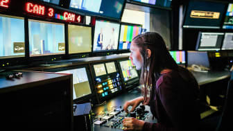 A person works in a TV control room