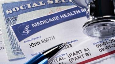 Medicare benefits card atop a Social Security benefits card