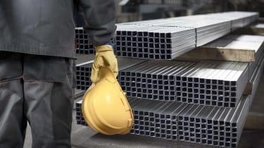 construction worker standing in front of steel beams
