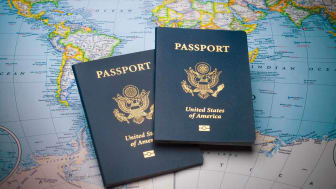 Two passports atop a map