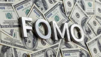 FOMO text on paper dollars.