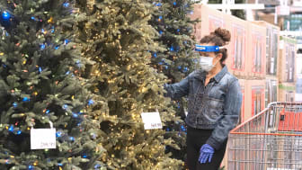 Woman shopping for a Christmas tree during the pandemic.