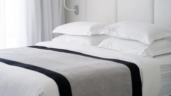 A mattress set with pillows, sheets and blanket