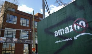 NEW YORK, NY - JANUARY 9: A protest message directed at Amazon is spray painted on a wall near a construction site January 9, 2019 in the Long Island City neighborhood of the Queens borough o