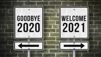 """picture of two signs saying """"Goodbye 2020"""" and """"Welcome 2021"""""""