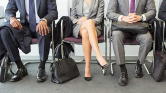 Job candidates wait for their interview