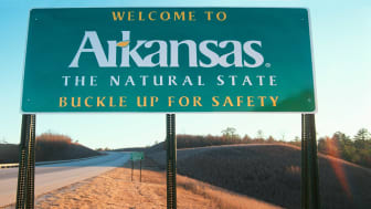 picture of welcome to Arkansas road sign
