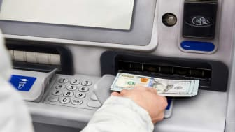 picture of person getting money from ATM