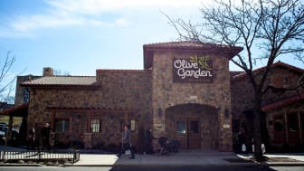 New York City, NY, USA - March 13, 2015: Street view of newly opened Olive Garden chain restaurant in Elmhurst Queens. Pedestrians on street. Chain restaurant is located directly across from