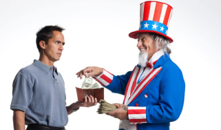 picture of Uncle Sam taking money out of a man's wallet