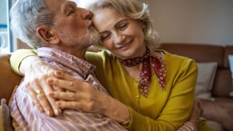 picture of elderly married couple embracing