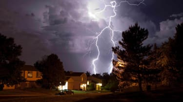 Picture of lightning striking behind house