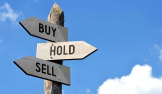 A signpost saying Buy Hold Sell