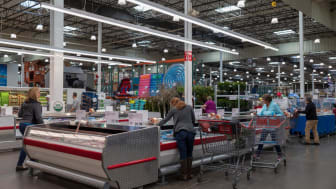 Shoppers in the meat and seafood sales are of Costco