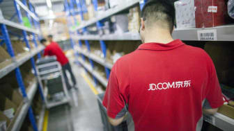 Gu'an, Сhina - June 14, 2016: JD.com staff receiving incoming goods, sorting products, and preparing shipments at the Northeast China based Gu'an warehouse and distribution facility