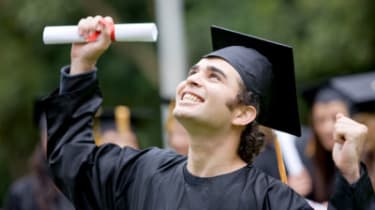 happy graduation student full of success outdoors