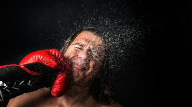 Sweating fighter is punched in the face