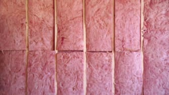 A wall of pink insulation in a new construction