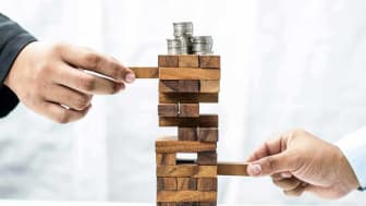 stacks of quarters balancing on top of a jenga game