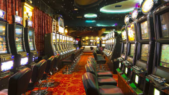A Slot machines room in an emptyCasino just before the opening time.