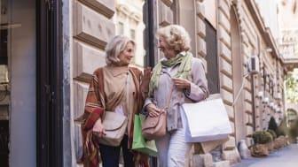 Senior women shopping, having fun and laughing on the street