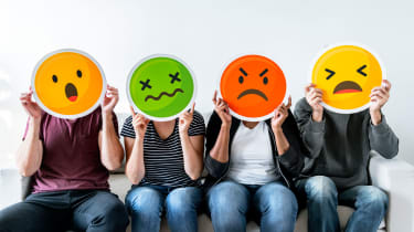 picture of four people holding up cardboard angry faces