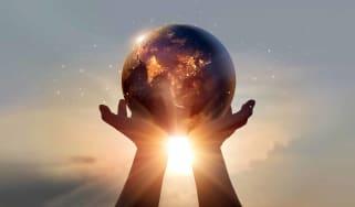 Earth held in human hands