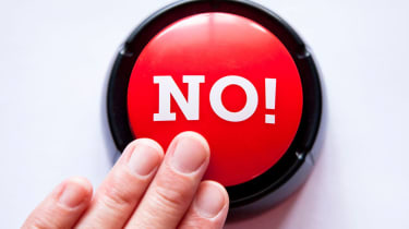 "Someone pushes a red button that is labeled ""No!"""