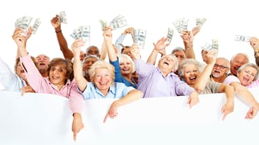 picture of happy elderly people holding money in their raised hands