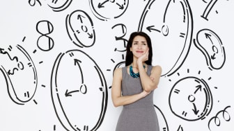 picture of woman with upset look on her face surrounded by drawings of clocks