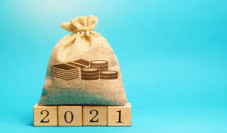 bag of money on blocks that say 2021