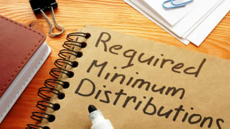"picture of a spiral notebook with ""Required Minimum Distributions"" written on the front cover"