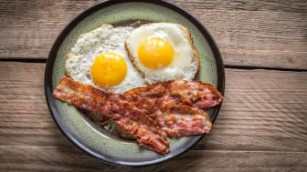 Cooked bacon and eggs on a plate